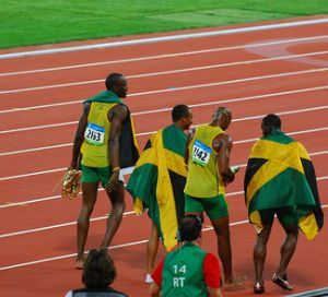 Usain Bolt doing victory lap with teammates at Beijing Olympics 2008