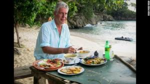 Anthony Bourdain sampling Jamaican food. Photo Credit - CNN.com