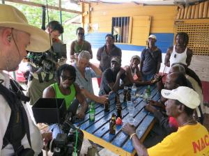 Bourdain and his film crew lyming with Jamaicans. Photo Credit - ZPZ Productions.