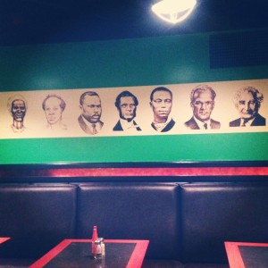 A mural with Jamaica's 7 National Heroes adorns the wall of Half Way Tree restaurant.